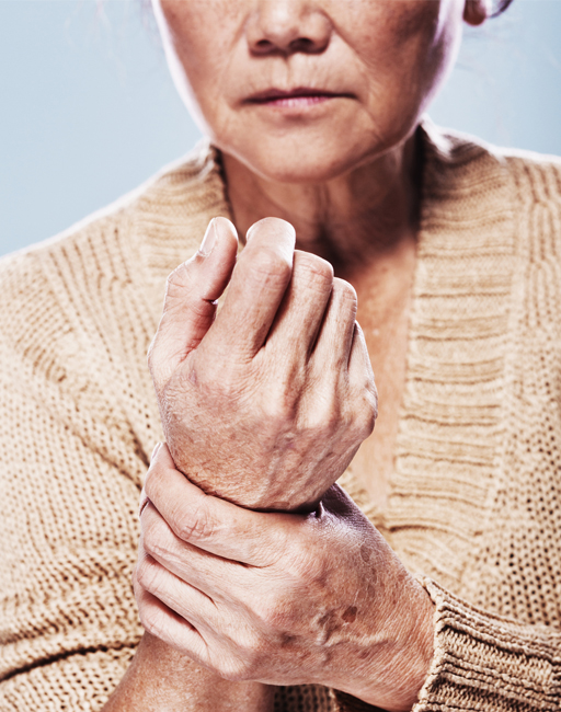 Weak Wrist Issues: A person holding her wrist